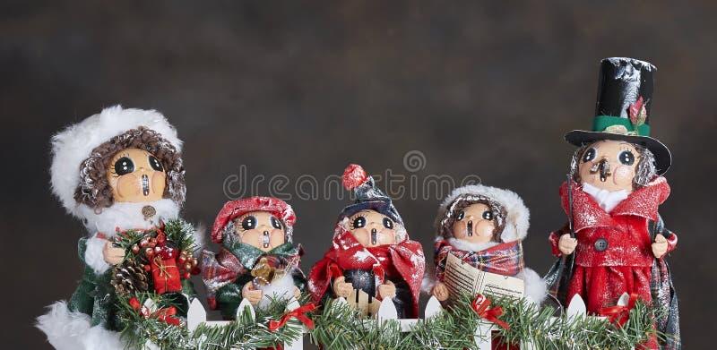 Carol Singers ornaments stock photography