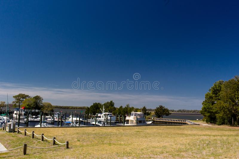 Carolina Beach State Park Marina on the South end of Snows Cut in North Carolina. Blue Sky, Boats, Trees royalty free stock image