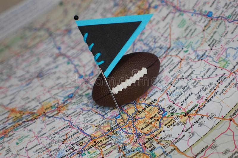 Carolina Panthers. Macro shot of a flag and football placed on Charlotte, North Carolina in a map royalty free stock image