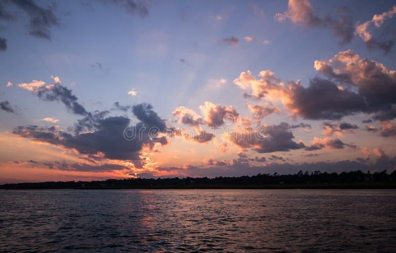Carolina Sunset. Sun sets along the Intercostal Waterway north of Wrightsville Beach, North Carolina stock image