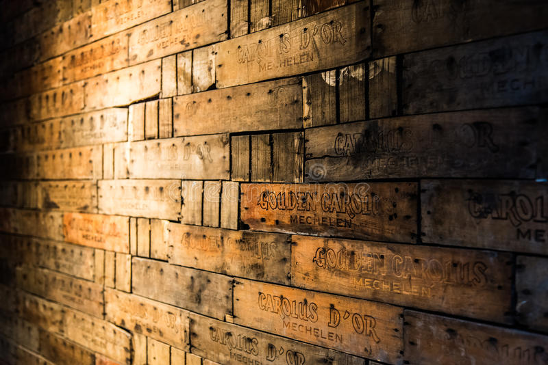 Carolus Beer Crates wall. Vintage Beer Crates wall composition lighted up at the Carolus brewery - Belgium 2016 stock photography