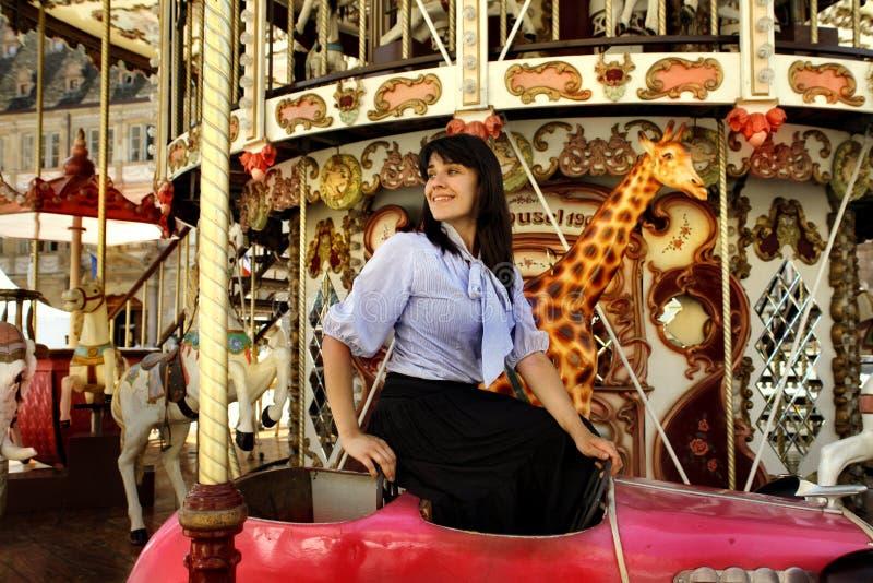 Carousel. Beautiful woman in a carousel stock photos