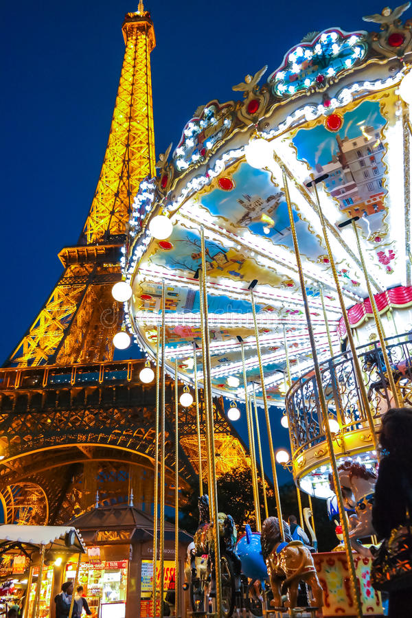 Carousel and the Eiffel Tower Paris France with night light. Image royalty free stock photography