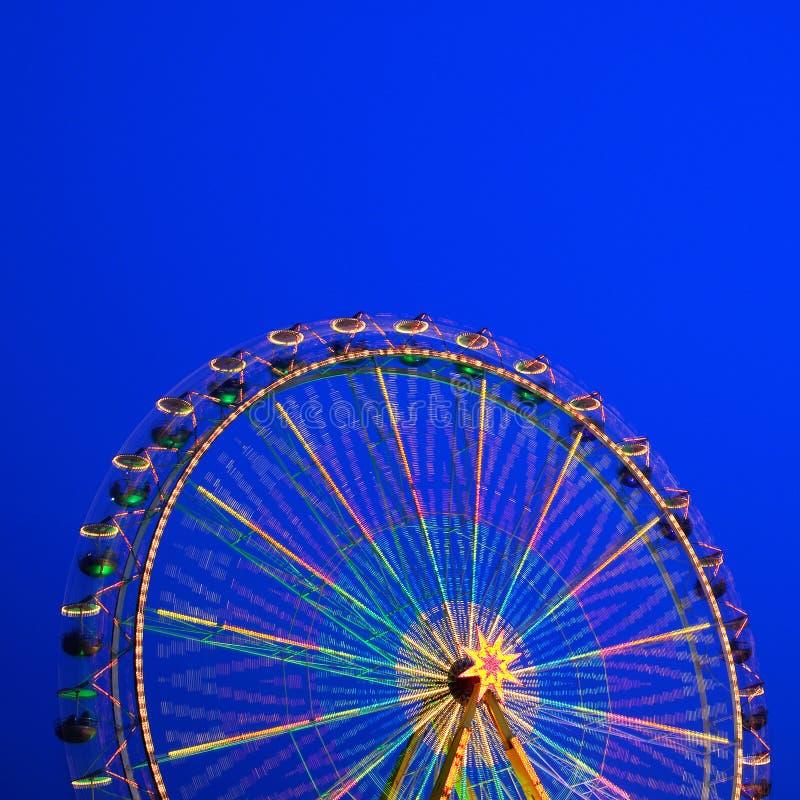 Carousel. Ferris Wheel on a blue background. stock photo