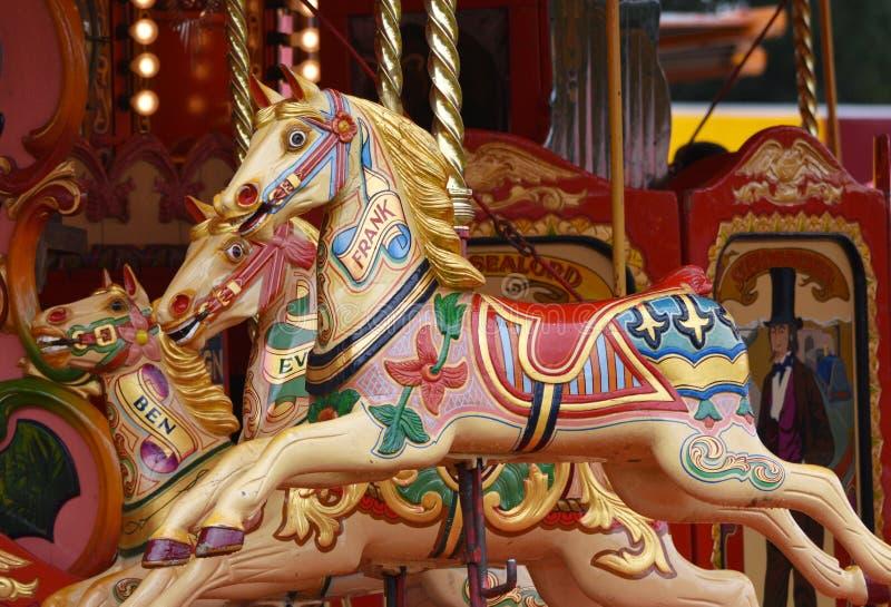 Carousel konie, Wesoło/Iść Round fotografia stock