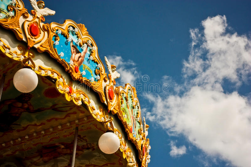 Carousel in the park with blue sky stock image