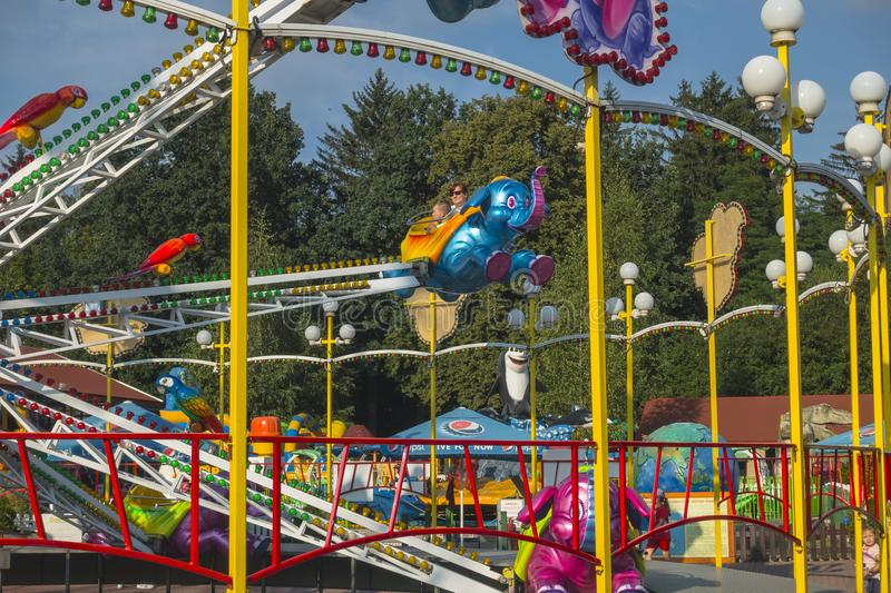 Zatorland Poland. Carousel and playgrounds for the kids in thematic park with dinosaurs in Zator ,Poland near Krakow royalty free stock photo