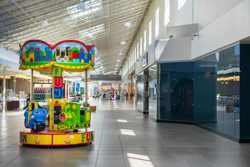 Carousel ride for kids at the mall. Childrens carousel ride in the middle of the mall stock image