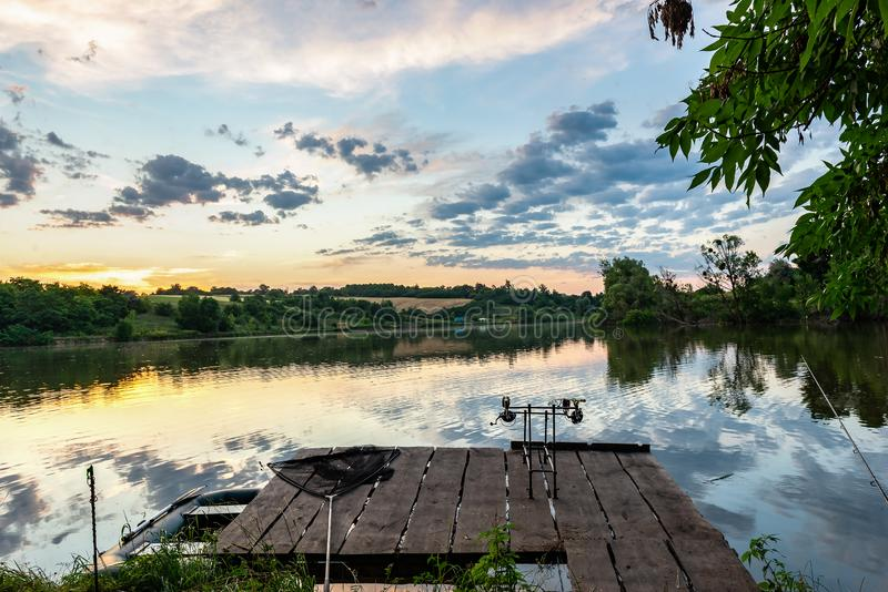 Carp fishing at sunset royalty free stock images