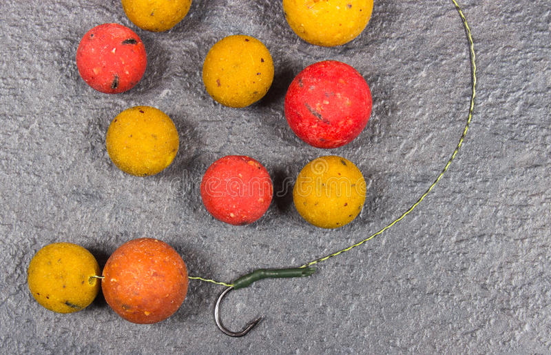Carp Hook Boilies - Fishing Bait close up. Carp Hook Boilies on black background royalty free stock photography