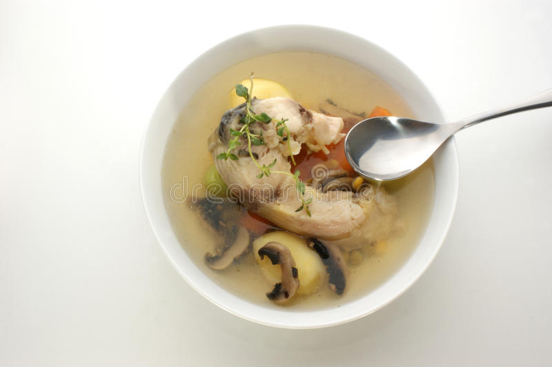 Carp soup with mushroom and fresh vegetables. Carp soup with mushroom and fresh organic vegetables royalty free stock image