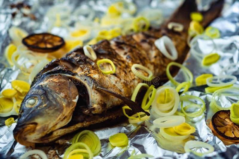 Carp whole foil dinner food. dish crucian stock images
