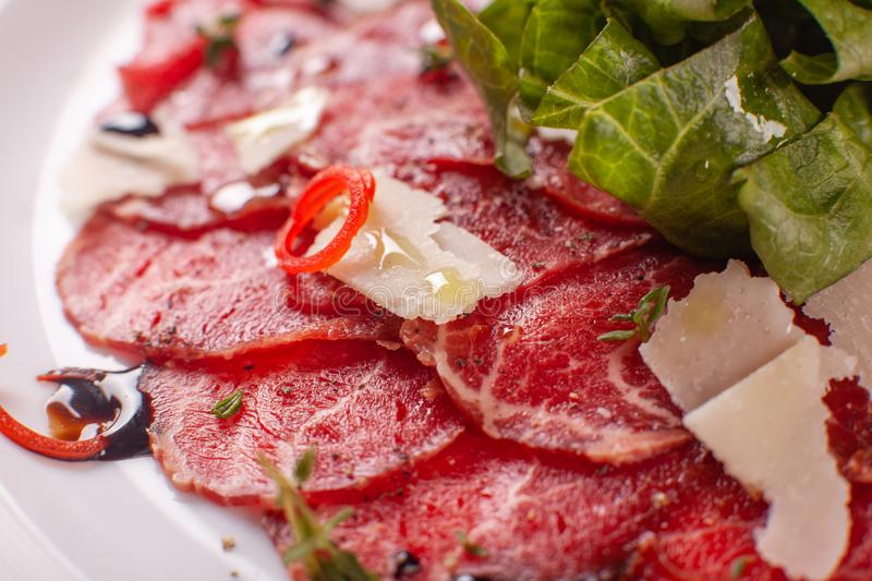 Carpaccio , beef steak salad. Summer launch, healthy eating concept. white plate with sauce. salad served in italian. Carpaccio , beef steak salad. Summer launch royalty free stock images