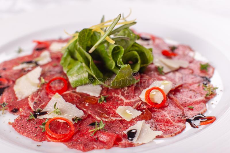 Carpaccio , beef steak salad. Summer launch, healthy eating concept. white plate with sauce. salad served in italian. Carpaccio , beef steak salad. Summer launch stock photography