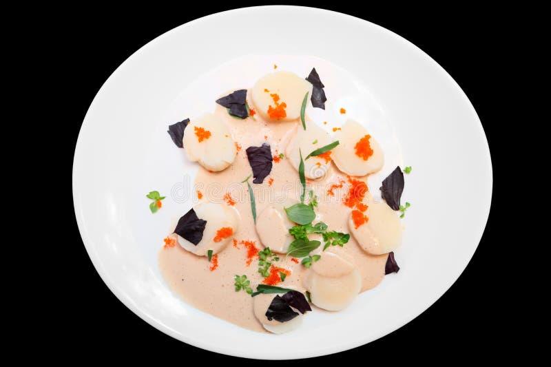 Carpaccio Scallop с косулями летучей рыбы, стоковое изображение