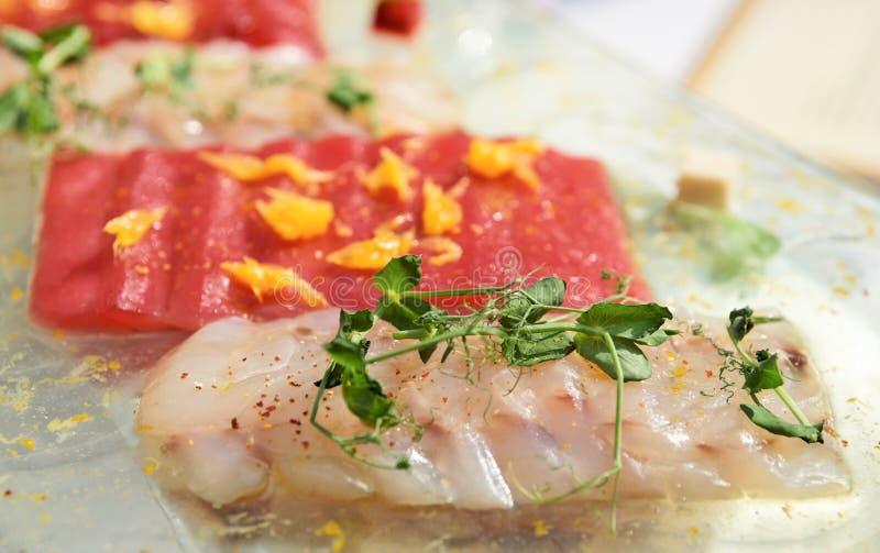Carpaccio of tuna and seabass. Close-up stock images