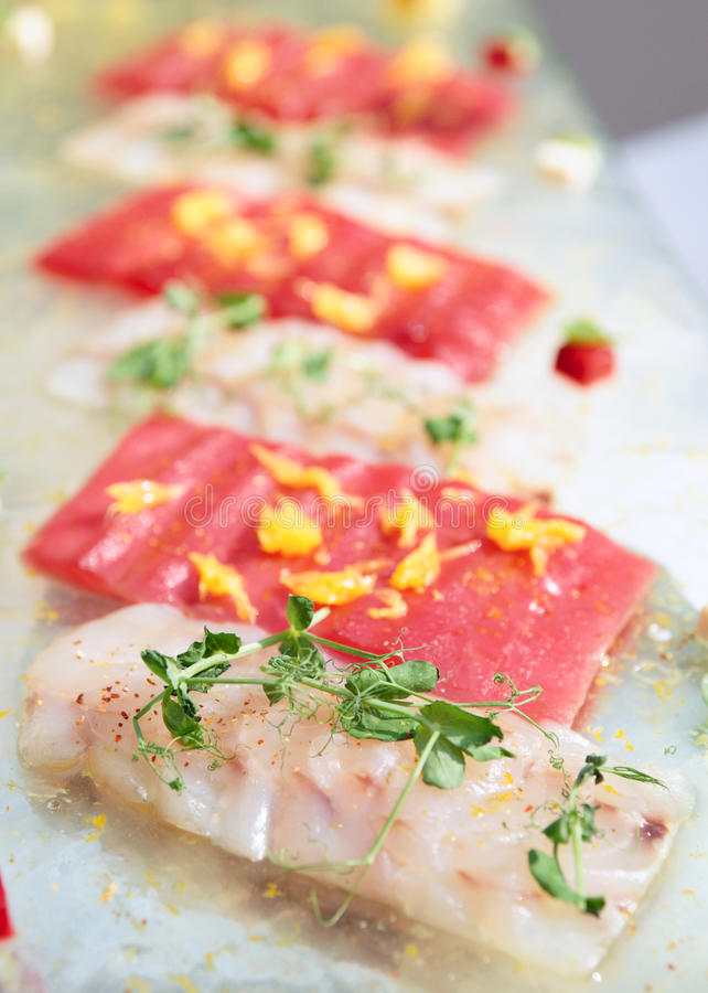 Carpaccio of tuna and seabass. Close-up stock image