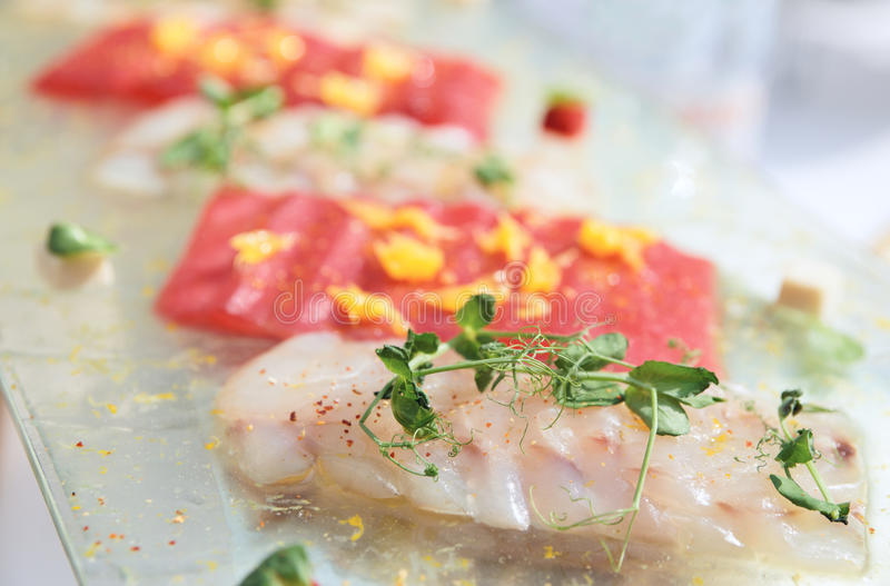 Carpaccio of tuna and seabass royalty free stock photo