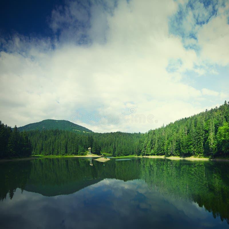 Carpathian mountain lake. Carpathian mountains summer landscape with lake Sinevir, retro style royalty free stock photo