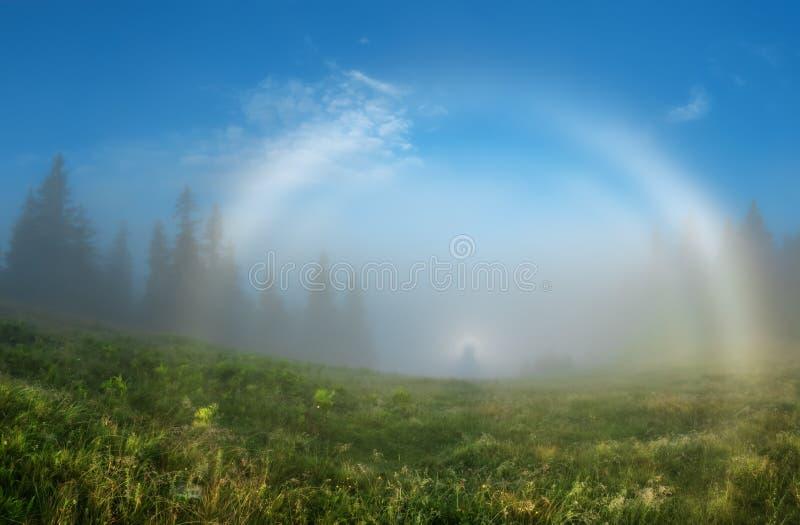 Carpathian Mountains. Brokensky ghost white double rainbow mist. royalty free stock image