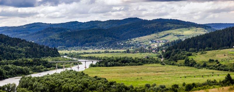 Carpathian rural landscape. A rural landscape at carpathian mountains with Striy river in the Carpathian national park Skolivski beskidy, Lviv region of Western royalty free stock image