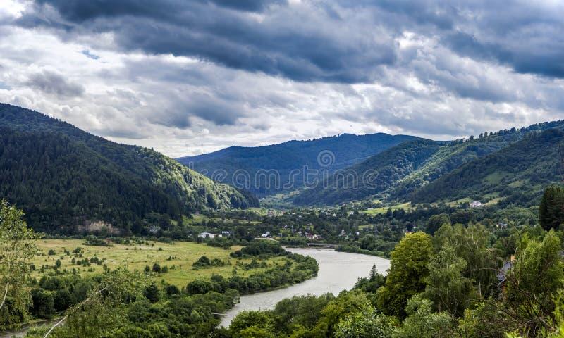 Carpathian rural landscape. A rural landscape at carpathian mountains with Striy river in the Carpathian national park Skolivski beskidy, Lviv region of Western royalty free stock photography