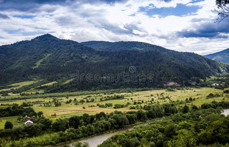 Carpathian rural landscape. A rural landscape at carpathian mountains with Striy river in the Carpathian national park Skolivski beskidy, Lviv region of Western royalty free stock images