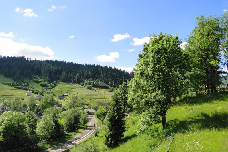 Carpathian village volosyanka ukraine. The countryside with beautiful landscapes, the mountains are covered with age-old forests, clean lakes and rivers in which royalty free stock photography