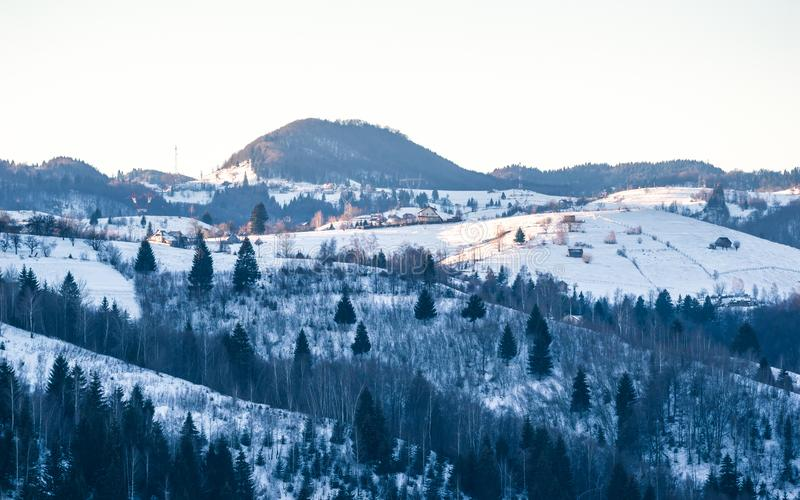 The Carpathians Bucegi Mountains Romania landscape winter snow ice clouds sunlight morning view royalty free stock photo