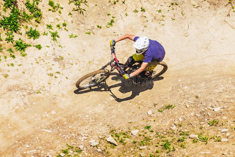 Carpathians, Ukraine. August 2019. A cyclist descends from a mountain at high speed, top view_ stock photos