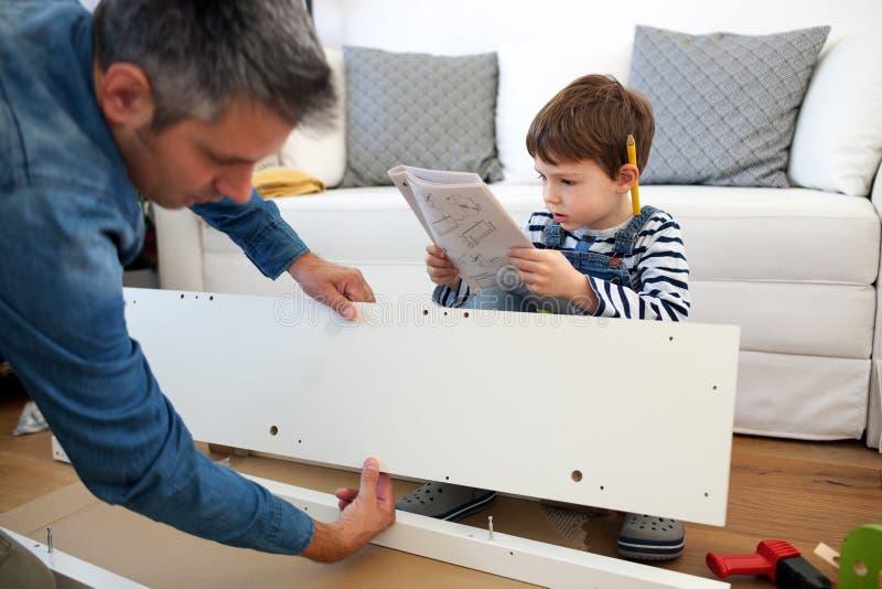 Carpenter's little helper stock photography