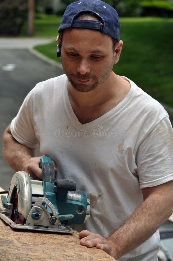 Download Carpenter stock photo. Image of green, white, sawing - 14497420