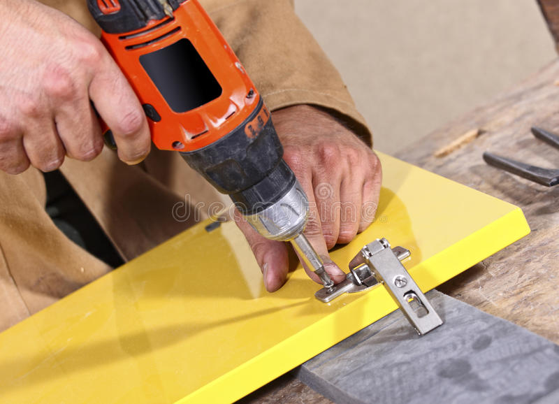 Carpenter in action stock images