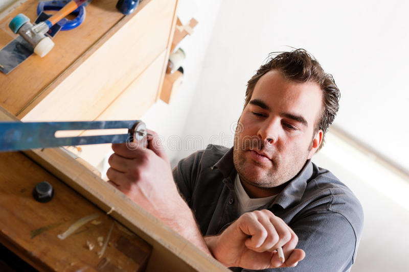 Carpenter with angle and pencil royalty free stock images