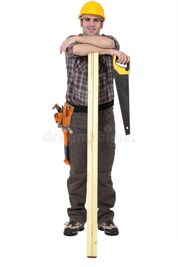 Carpenter with arms resting on lumber