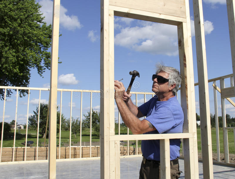 Carpenter Building a House stock photo