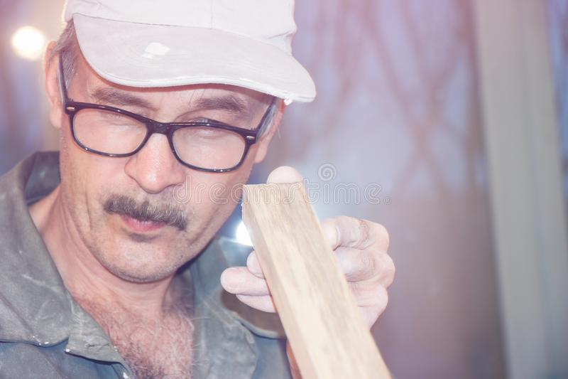Carpenter checks the Board royalty free stock photography