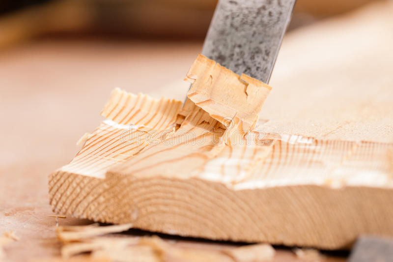 Carpenter with chisel stock images