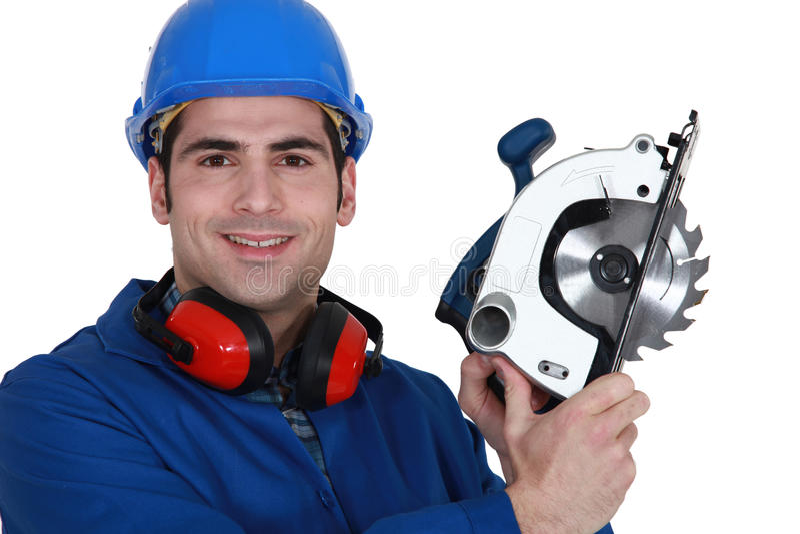 Download Carpenter With A Circular Saw. Stock Photo - Image: 26703066