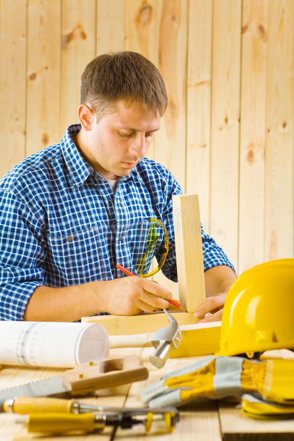 Download Carpenter Does The Sketching Stock Photo - Image of backgrounds, handsaw: 25829080