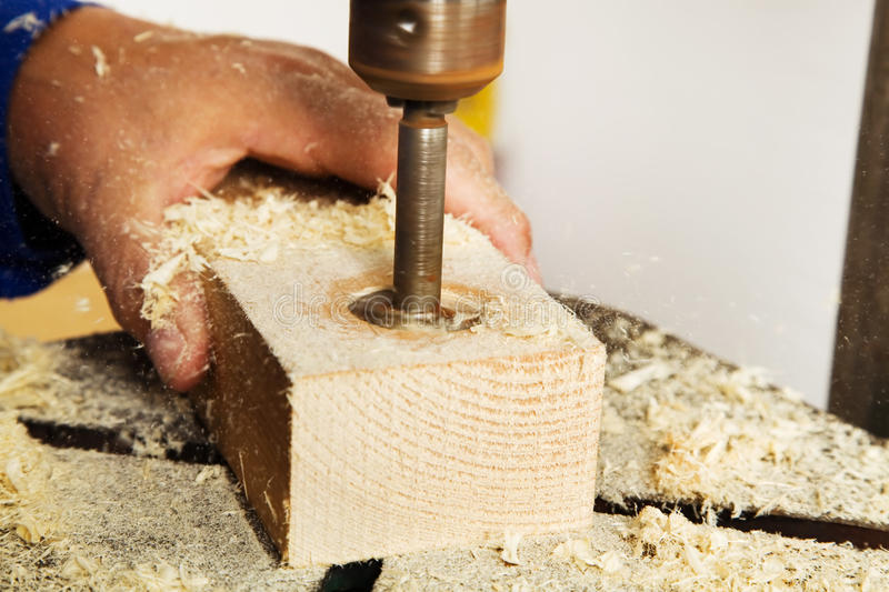 Carpenter At A Drill Royalty Free Stock Photography