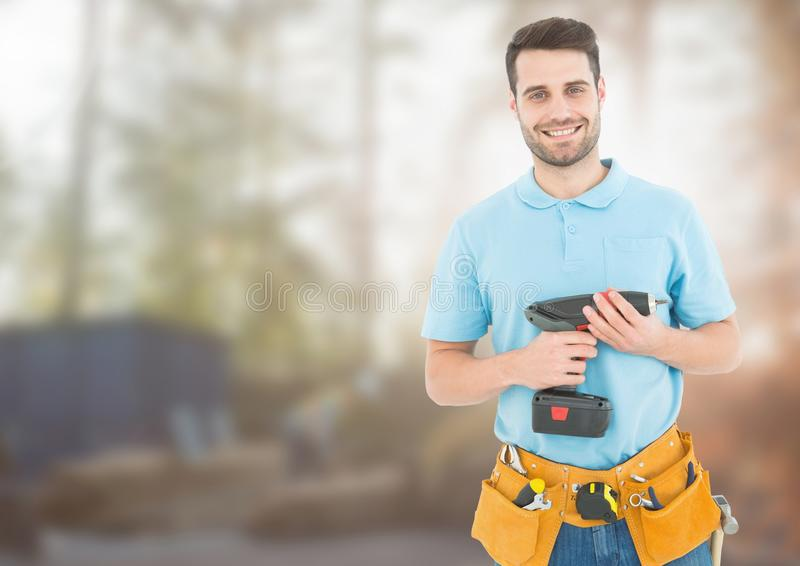Carpenter with drill on building site royalty free stock image