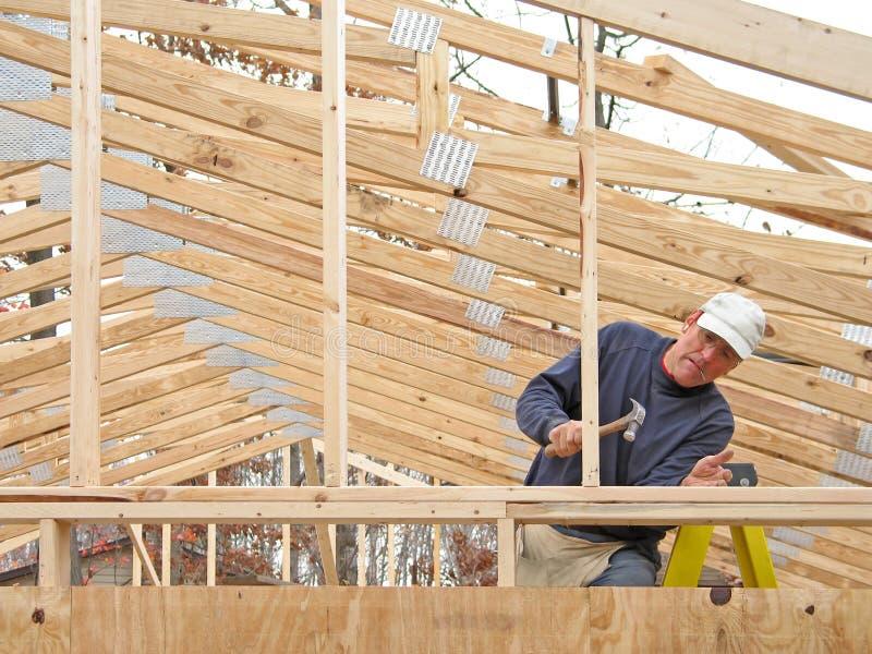 Carpenter framing house royalty free stock image