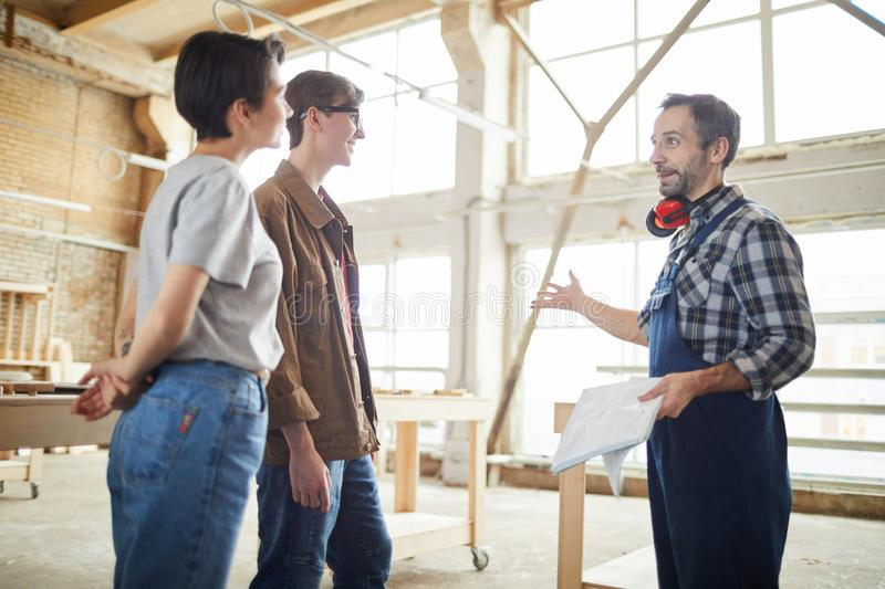 Carpenter Giving Tour of Factory royalty free stock images