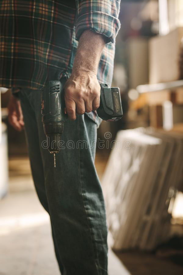 Carpenter with a hand drill machine royalty free stock images