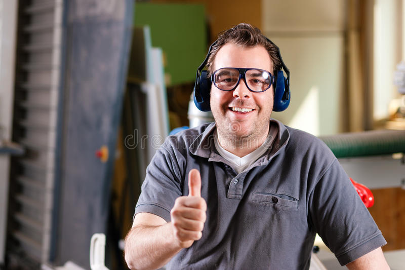 Carpenter in his workshop royalty free stock image