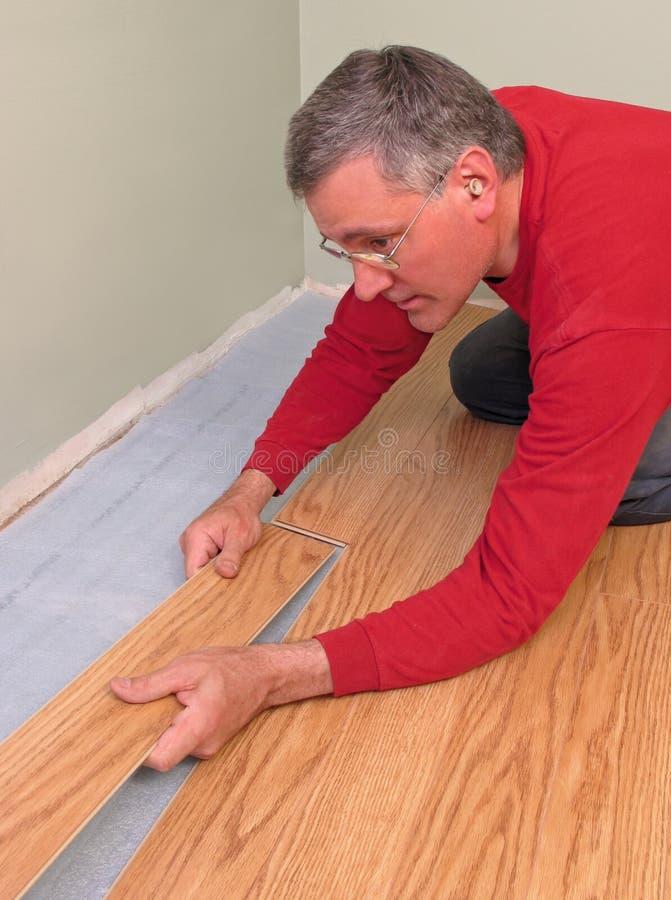 Carpenter installing floor royalty free stock image