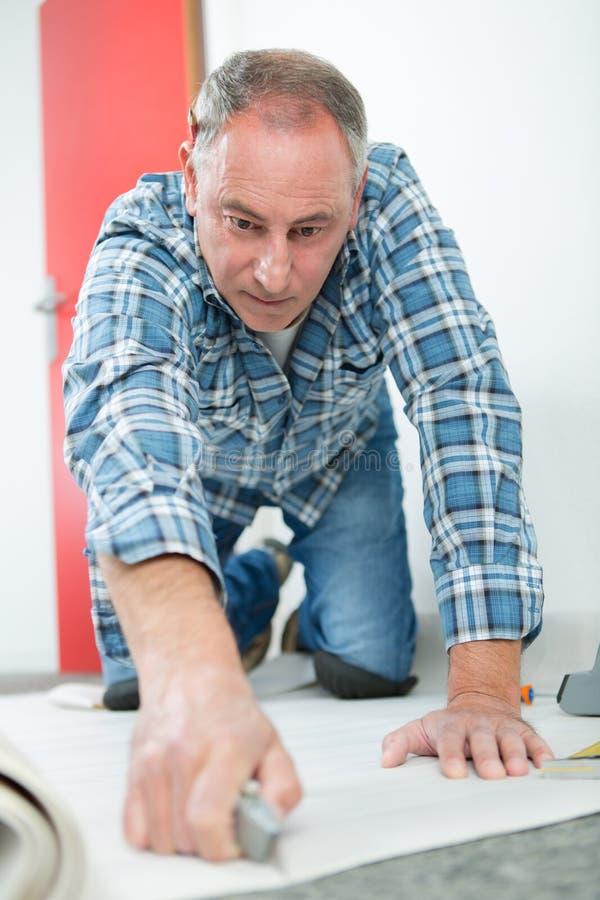 Carpenter joiner worker preparing door frame for indoor installation royalty free stock image