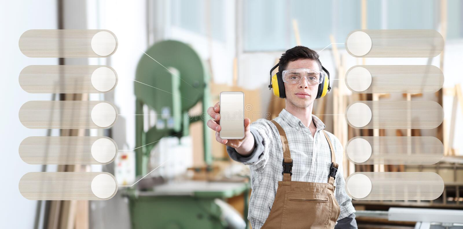 Carpenter man show the mobile phone with infographic of wooden empty symbol icons on carpentry background. Carpenter man show the mobile phone with infographic royalty free stock photography