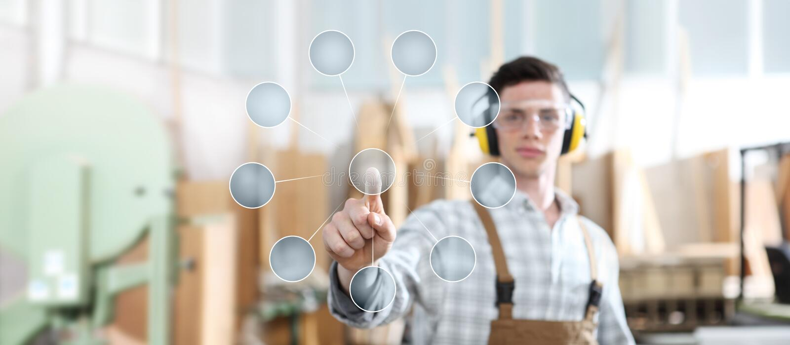 Carpenter man touch screen with empty symbol icons on carpentry background stock photo
